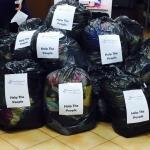 Mii de articole vestimentare, donate de Magazinul Caritabil SocialXchange